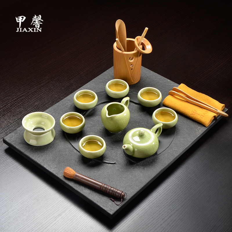 A hope tea set kung fu tea set package with the entire piece of black stone black stone tea tray taiji crack porcelain tea set