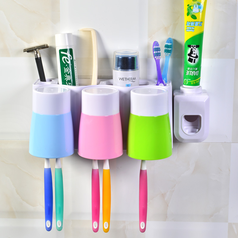 Creative wall suction toothbrush holder tumbler cup suction wall rack automatic toothpaste dispenser with a cup wash suit