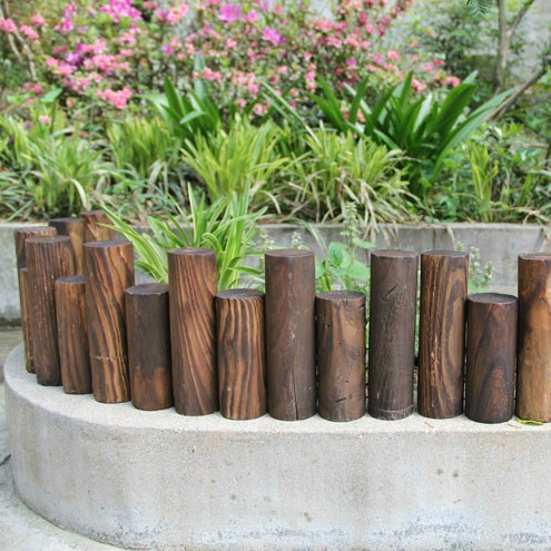 Get Quotations · Cylindrical Stakes Carbonized Wood Fence Wood Fence  Flowerbed Antique To Do The Old Wooden Fence Garden
