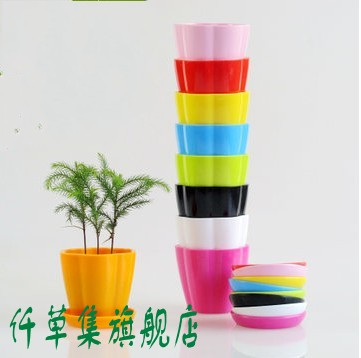 Qian grass set pumpkin colored resin flower pots plastic pots have water hole with a tray
