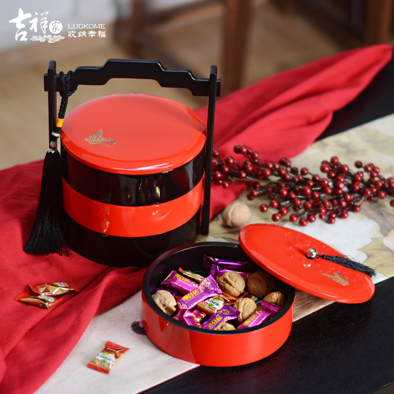 The new chinese auspicious lacquer box [sheng makeup] black and red circular wooden storage box candy wedding gift
