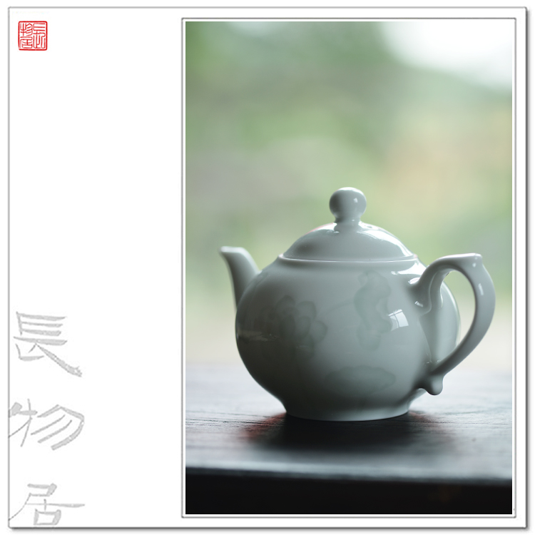 View of the dark carved lotus flavor shadow green glazed porcelain teapot porcelain antique handmade jingdezhen ceramic tea