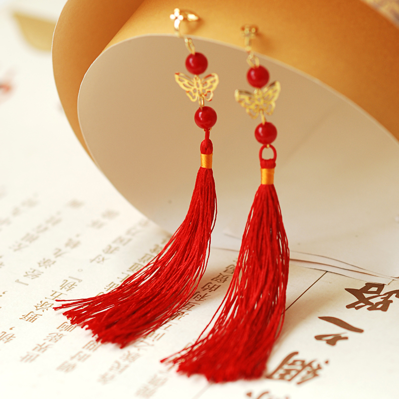 high school and red tassel thing