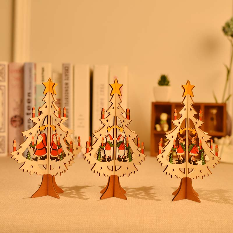 Carved wooden christmas decorations christmas tree santa claus snowman brown deer st. desktop with christmas decorations