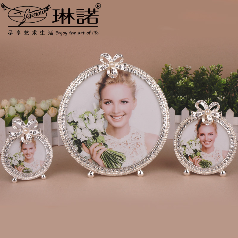 Children's creative wedding photo frame baby photo frame swing sets european round metal inlay diamond photo frame 348 7-inch photo frame