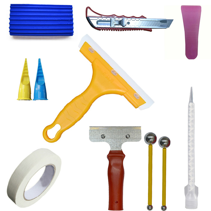 Construction tools tile seam pressure ball blade slotted blade slot is masking tape glue gun glue nozzle