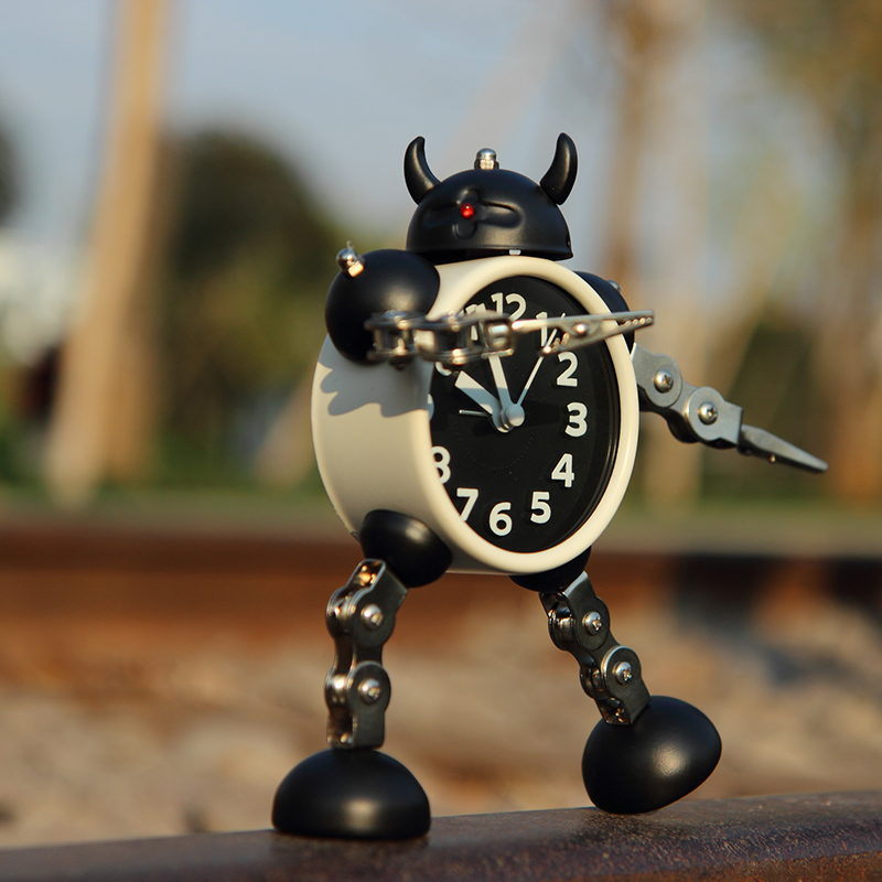 Deformation robot alarm clock creative student small alarm clock cute children's cartoon alarm clock table clock clock metal clock