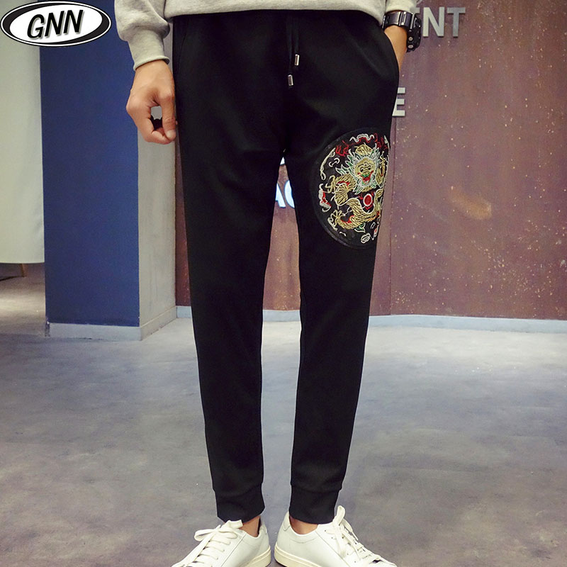 8c2cc178a Get Quotations · Gnn autumn new black jogging pants male korean slim casual pants  pants big yards youth embroidered