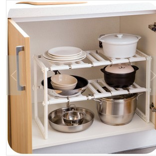 Kitchen with stainless steel sink under any telescopic retractable shelf storage rack storage rack shelving multilayer show