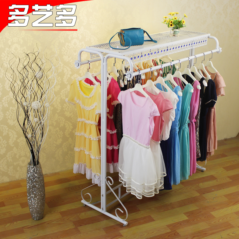 New clothing rack in the island shelf clothing store display floor clothing store clothing hanger floor display racks