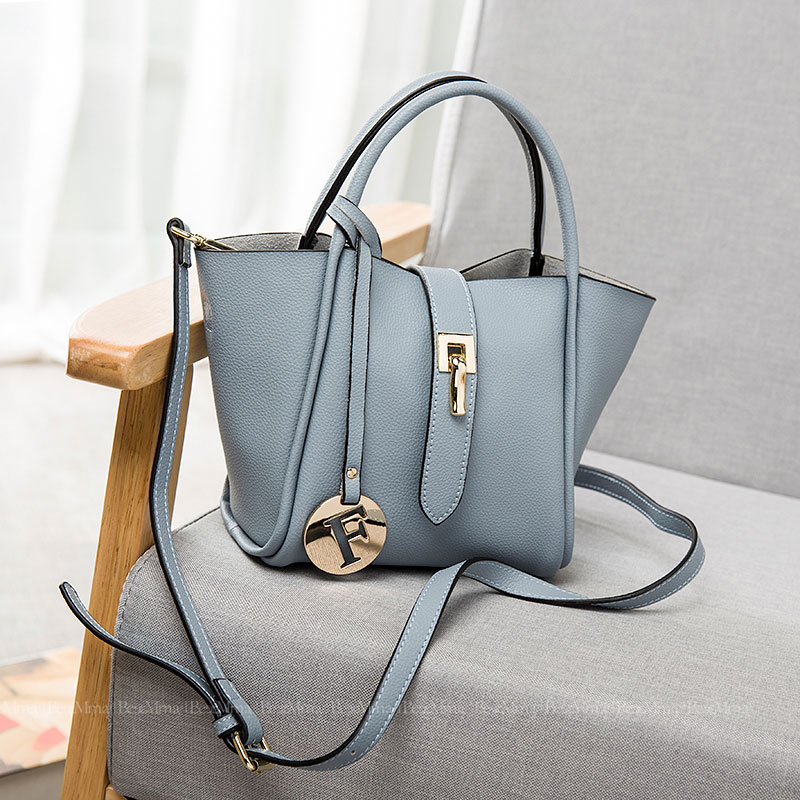 6692fd7927 Get Quotations · New female bag 2016 charm fashion leather buckle fashion  reccurence of wings tide portable shoulder bag