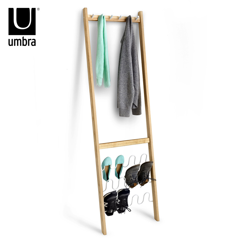 Umbra floor against a wall shoe rack coat rack clothes rack hanger creative fashion clothing store ikea simple clothes rack