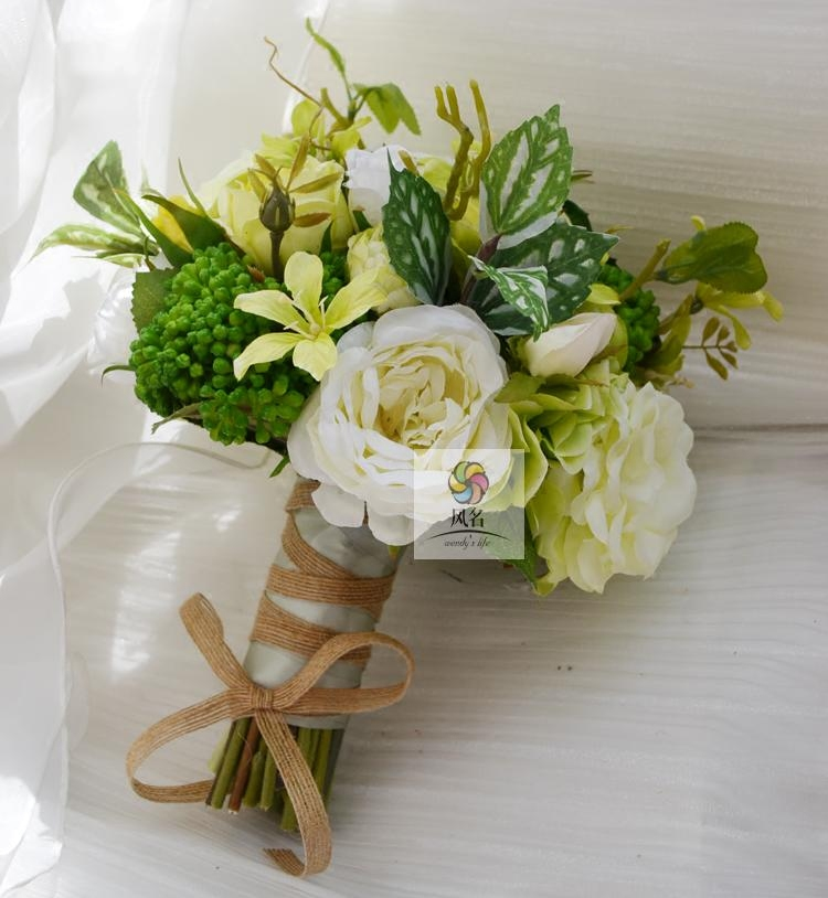 Wind name handmade artificial flowers wedding floral bride holding flowers white roses green succulents