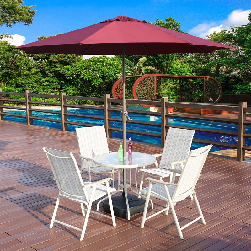 Wrought iron teslin outdoor recreation outdoor garden terrace patio home with a combination of large parasol