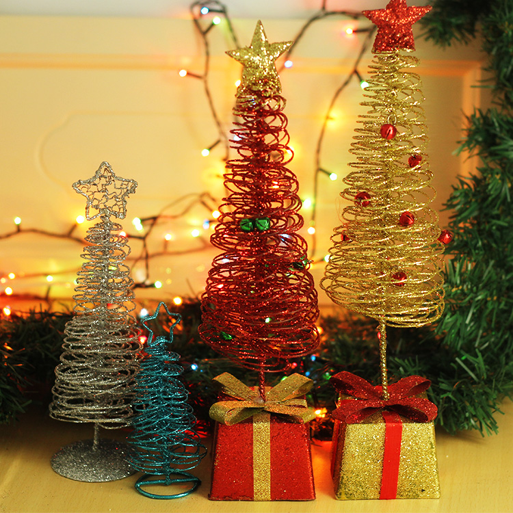 At the end of christmas gift boxes decorated wrought iron christmas tree decorations arranged christmas gift desktop decoration