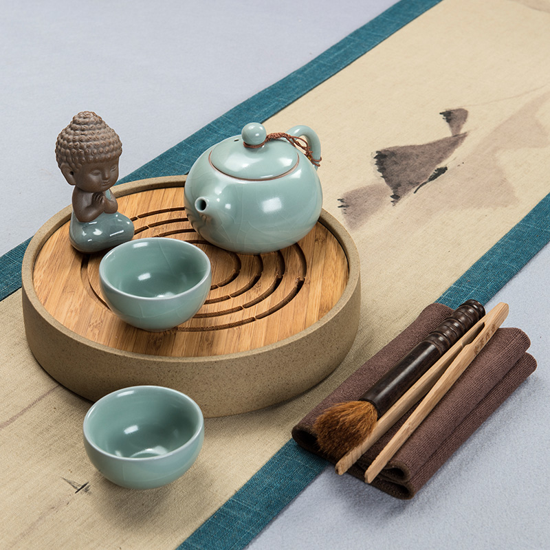 East west tea pot stoneware pottery and porcelain tea tray tea pot two cups group storage petty style tea tray tea set