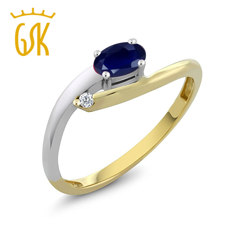 Gsk oval sapphire ms. yellow and white k gold mixed with white diamond wedding ring finger