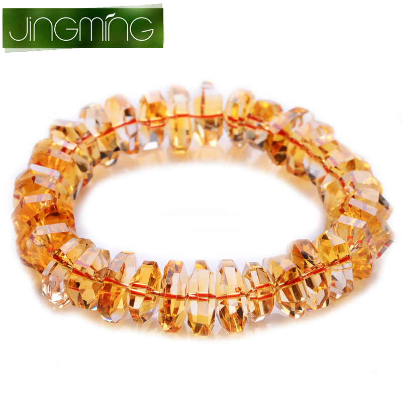 Jing ming golden color faceted crystal of large particles of brazilian citrine with the shape of male and female models