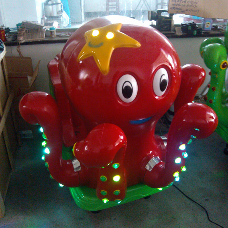 Photosynthetic octopod children electric swing machine coin shook his music cartoon octopus swing car swing machine thin