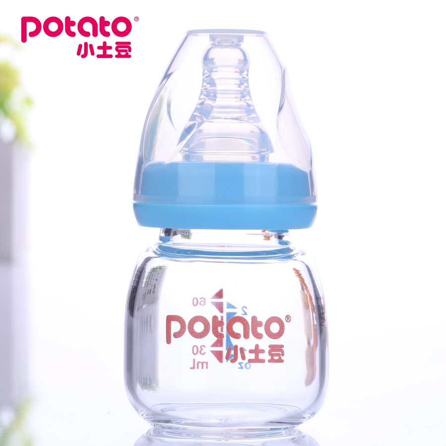 Small potatoes small bottle of juice bottle newborn baby given medicines to drink a glass bottle silicone nipple s
