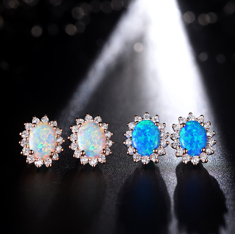 The new rose gold opal IRAYNE2015 synthetic opal silver earrings temperament models noble gift for her mother