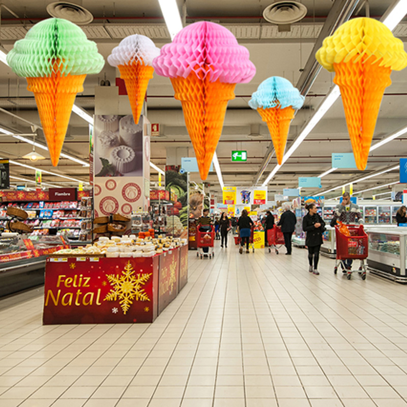 Festive ornaments decorate the roof ceiling storefront shop shopping activities arranged kindergarten paper ice cream