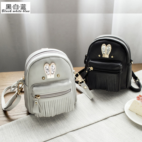 7377ced7d07b Get Quotations · New korean fashion handbags fringed shoulder bag in black  and white and blue mini backpack shoulder