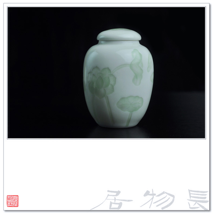 View of the flavor shadow green glazed porcelain tea caddy warehouse chaguan dark carved lotus jingdezhen handmade ceramic tea cup